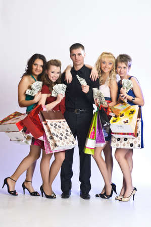 women with shopping bags take money from the man Stock Photo - 10778491