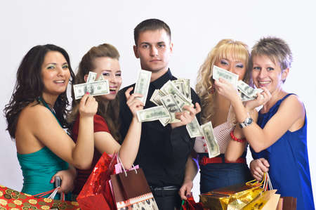 spending: women with shopping bags take money from the man Stock Photo