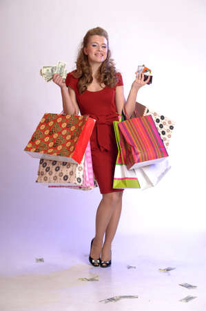 girl with shopping, money and credit cards photo