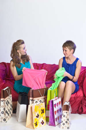 Two girl friends with shopping bags Stock Photo - 10510075