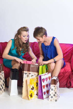 Two girl friends with shopping bags Stock Photo - 10510074