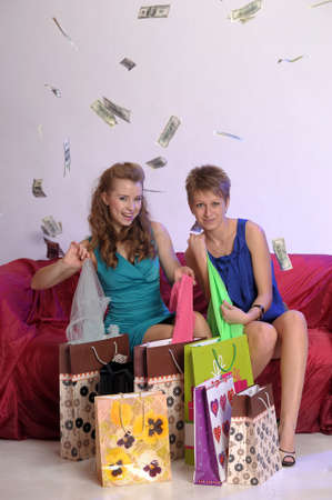 Two girl friends with shopping bags photo