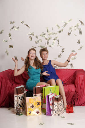 Two girl friends with shopping bags Stock Photo - 10509862