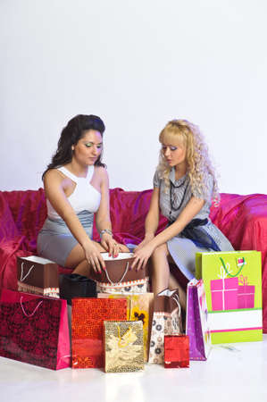 gladness: Two girl friends with shopping bags