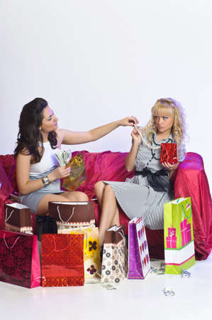 Two girl friends with shopping bags Stock Photo - 10509894