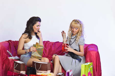Two girl friends with shopping bags Stock Photo - 10509879