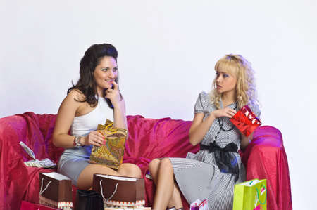 red couch: Two girl friends with shopping bags