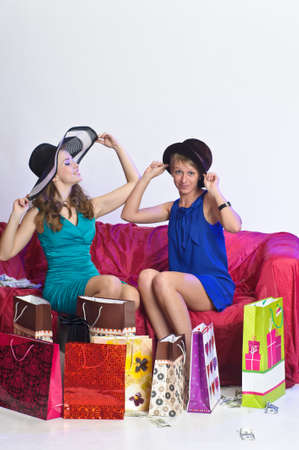 redhead woman: Two girl friends with shopping bags
