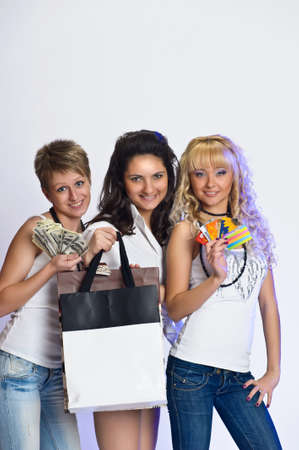 Three girls with money, shopping and credit cards Stock Photo - 10584441