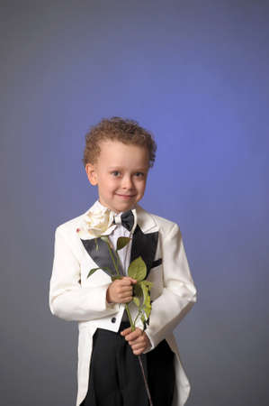 frock coat: boy in a frock coat with a white rose