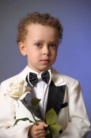 boy in a frock coat with a white rose Stock Photo - 12024118