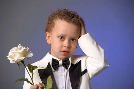 boy in a frock coat with a white rose Stock Photo - 12024117