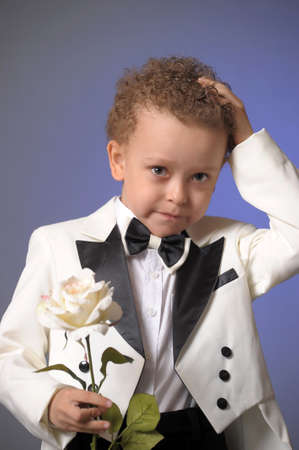 boy in a frock coat with a white rose Stock Photo - 12024120