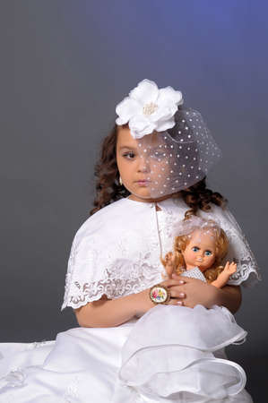 retro portrait of a young girl in a white hat with a veil photo