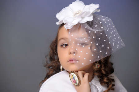 retro portrait of a young girl in a white hat with a veil Stock Photo - 12018923