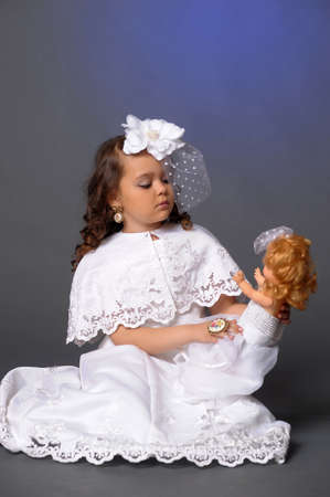 The little girl with doll Stock Photo - 13754824