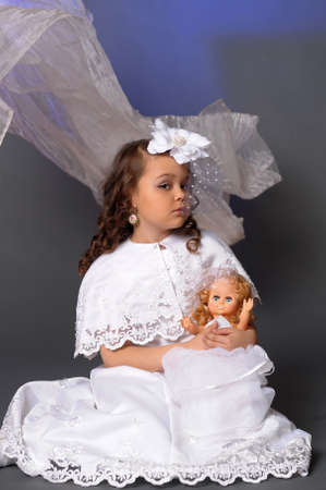 The little girl with doll Stock Photo - 13754825