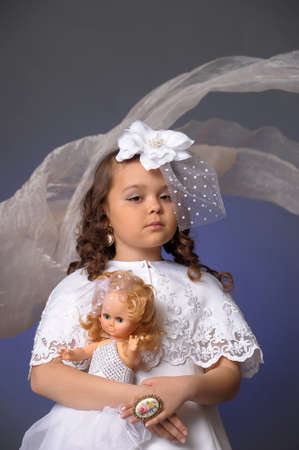 The little girl with doll photo