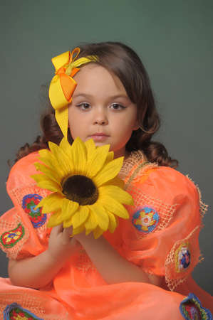 girl with a sunflower in the studio Stock Photo - 11499591
