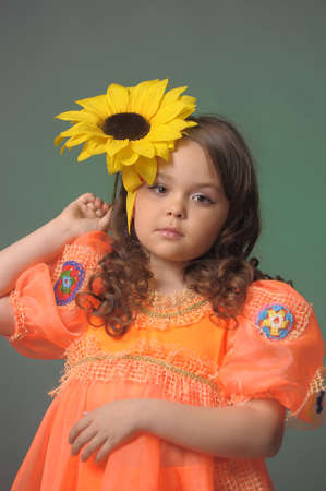 girl with a sunflower in the studio photo