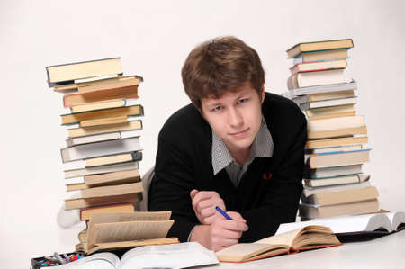 The student with a considerable quantity of books Stock Photo - 10243960