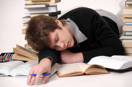The student with a considerable quantity of books Stock Photo - 10243962