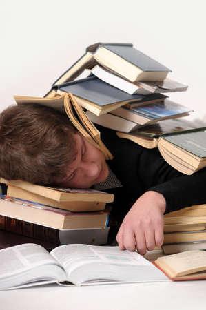 student sleeping among the books photo
