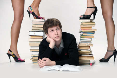 The student with a considerable quantity of books Stock Photo - 11511332