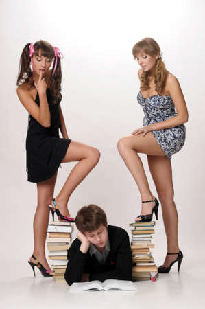 young man and two girls prepare for examinations Stock Photo - 13281007