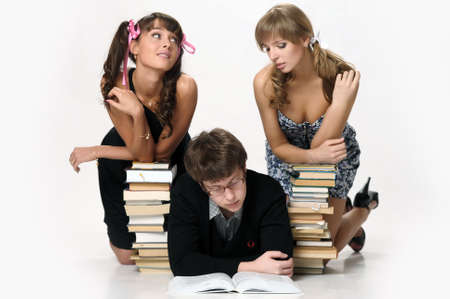 young man and two girls prepare for examinations photo