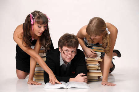 young man and two girls prepare for examinations Stock Photo - 13280701