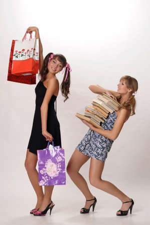 sell out: Shopping girl and a student with books