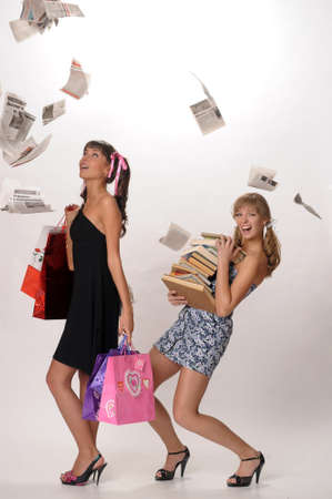 Shopping girl and a student with books Stock Photo - 10077517
