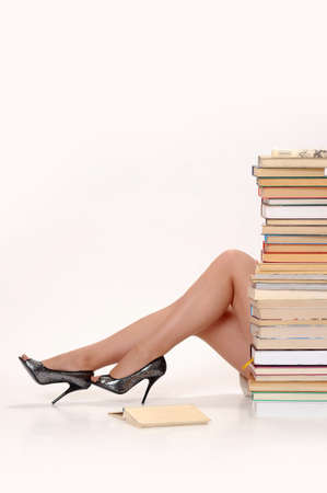 young woman next to a large Number of books
