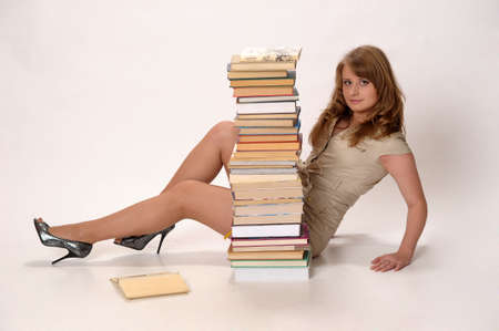 young woman next to a large Number of books photo