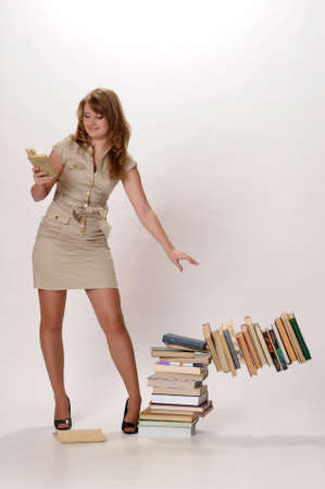 girl falling concealing a pile of books photo