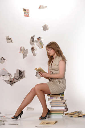 young woman next to a large Number of books Stock Photo - 10077433