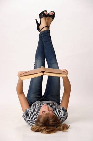 upside down: girl reading a book