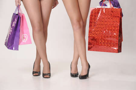 Woman holding colorful shopping bags photo