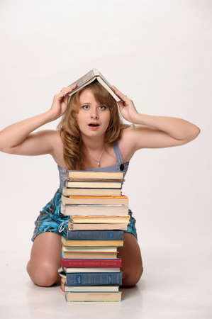 illiterate: Girl with books