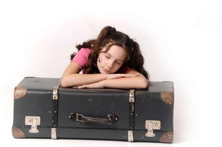 sleeping bag: girl sleeping in an old suitcase