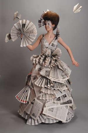 Portrait of a beautiful girl in a newspaper dress photo