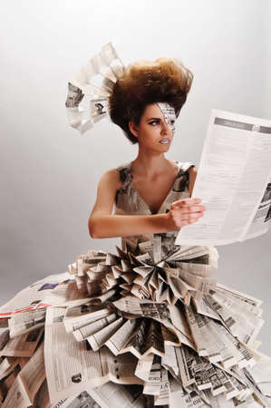 girl in a dress from newspapers Stock Photo - 9669455