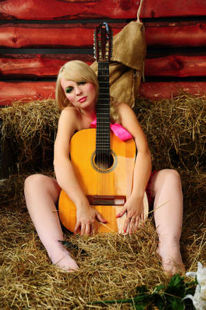 The blonde with a guitar photo
