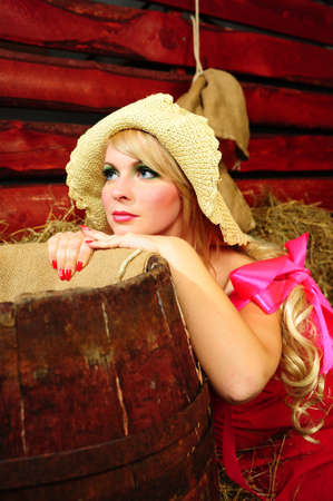 Country girl on hay photo