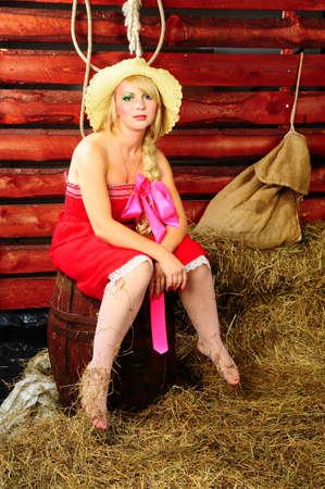 wheel barrel: Country girl on hay