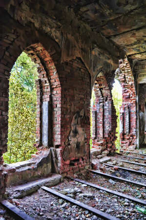 the ruins of an old brick house photo