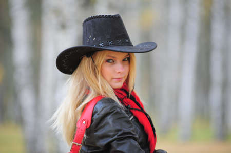 barn boots: young blonde in a cowboy hat