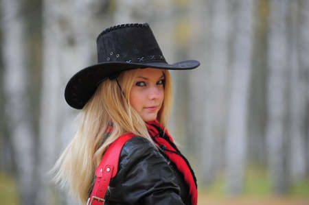 up country: young blonde in a cowboy hat