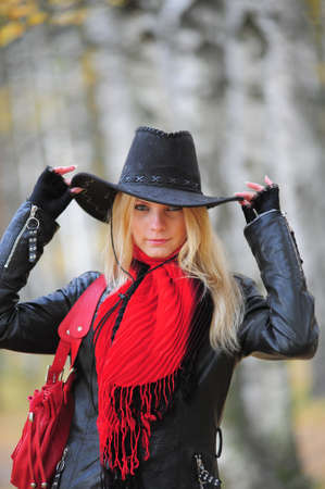 black cowgirl: young blonde in a cowboy hat